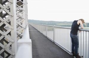 http://www.dreamstime.com/royalty-free-stock-photo-man-bridge-contemplating-suicide-image20691685