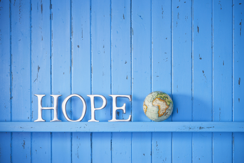 http://www.dreamstime.com/royalty-free-stock-photo-hope-world-globe-background-blue-painted-wood-word-image40070135